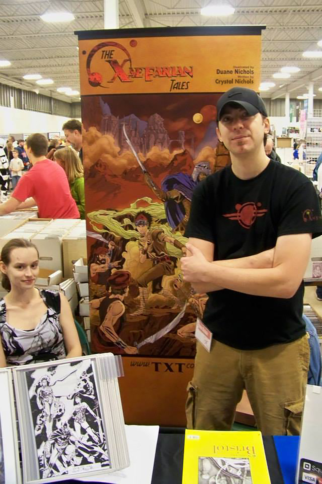 Duane and Crystal Nichols at The Xaefarian Tales table at a convention